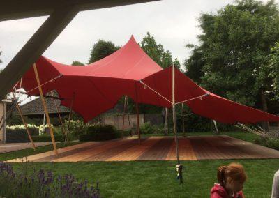 Rode stretchtent 10x10 m. met vloer